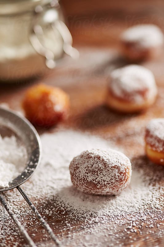 Donut holes with icing sugar by Martí Sans for Stocksy United