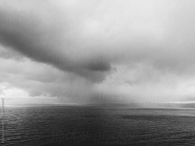 Dark & stormy clouds over Puget Sound, from Vashon Island Ferry, Seattle, WA by Paul Edmondson for Stocksy United