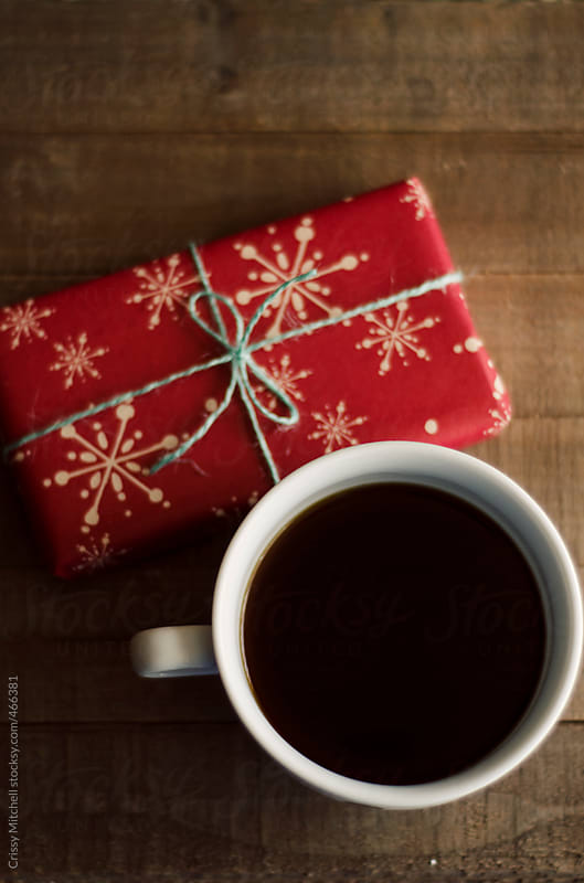 coffee and a present. by Crissy Mitchell for Stocksy United