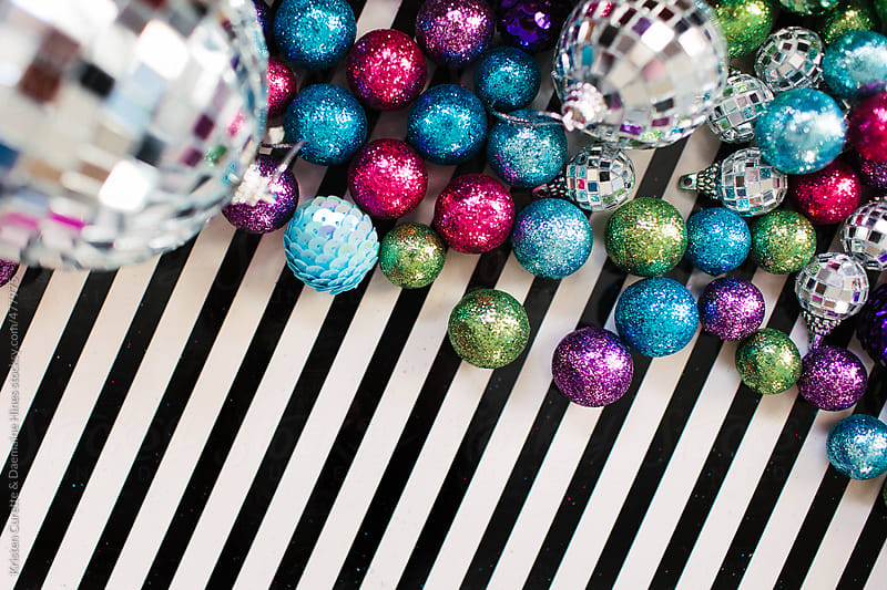A group of big and small ornaments and disco balls  by Kristen Curette Hines for Stocksy United