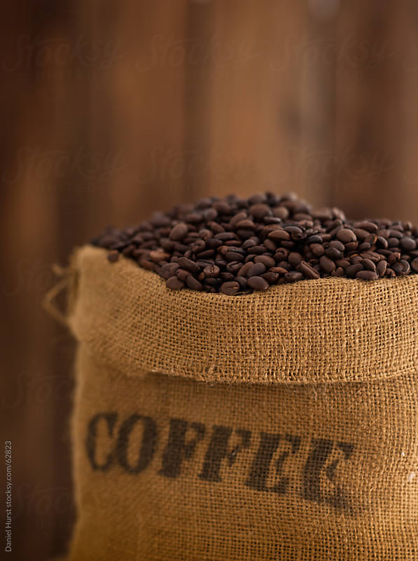 Bag of coffee beans by Daniel Hurst for Stocksy United