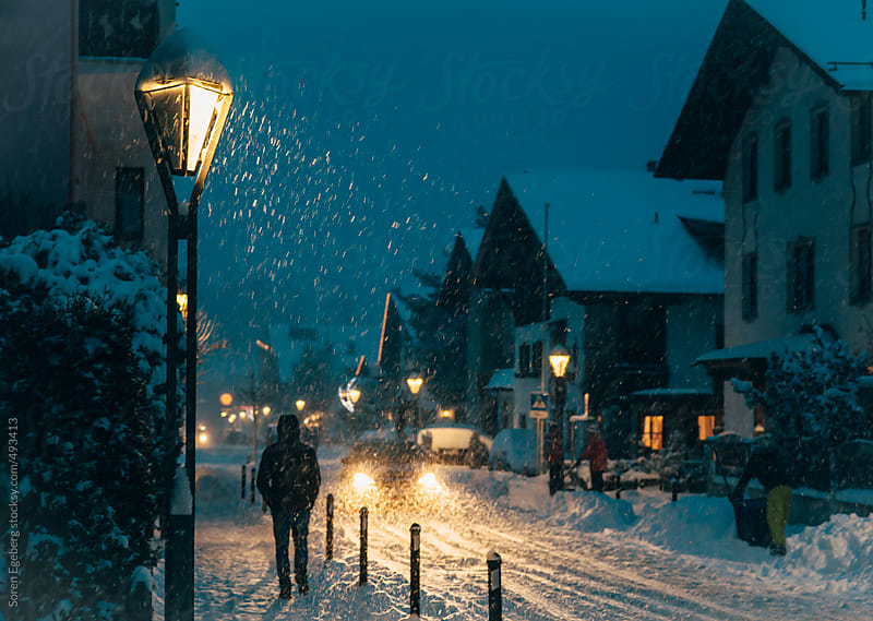 Cozy night atmosphere in asnow covered mountain village in Austria by Soren Egeberg for Stocksy United