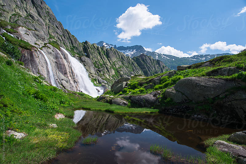 Watterfall in the swiss mountains at lake Grimsel by Peter Wey for Stocksy United