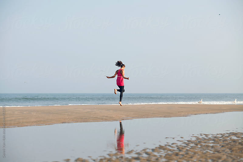 Healthy woman works out with jump rope on the beach  by Denni Van Huis for Stocksy United