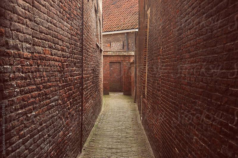 brick corridor by Sonja Lekovic for Stocksy United
