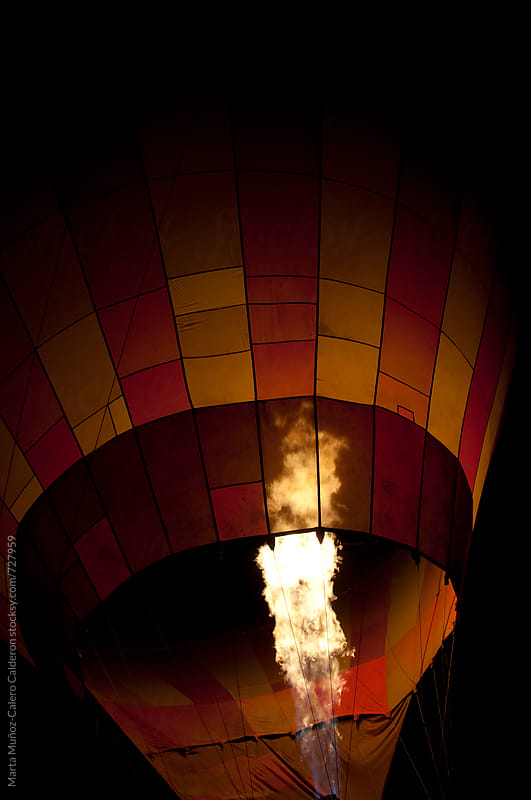 Flames Burst Out in a Hot Air Balloon  by Marta Muñoz-Calero Calderon for Stocksy United
