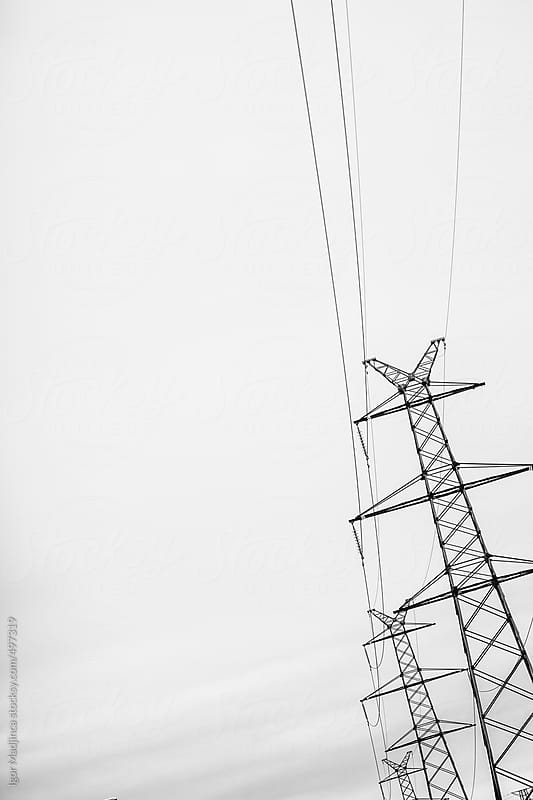 transmission line, electricity, power by Igor Madjinca for Stocksy United