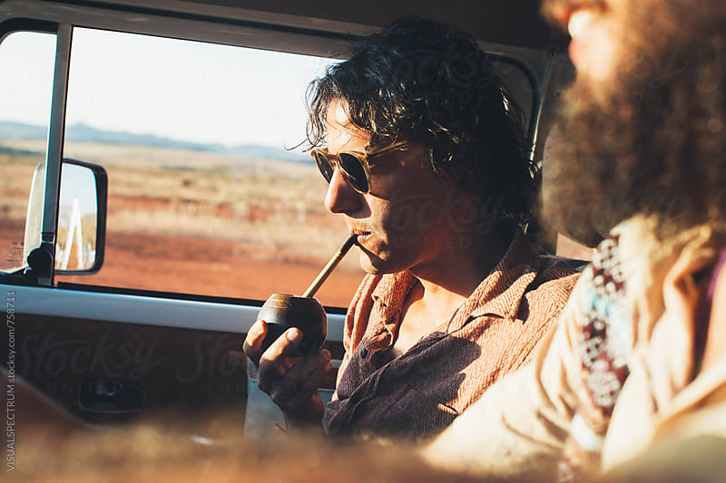 On The Road - Young Latino Man Drinking Mate on Road Trip With Camper Van by Julien L. Balmer for Stocksy United