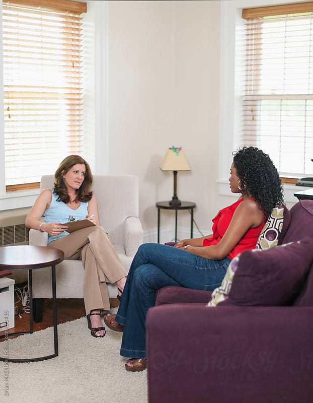 Therapy: Patient Talks to Counselor in Therapists Office by Brian McEntire for Stocksy United