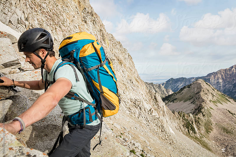 Alpinist Climbs Rocky Mountain Face by Odyssey Stock for Stocksy United