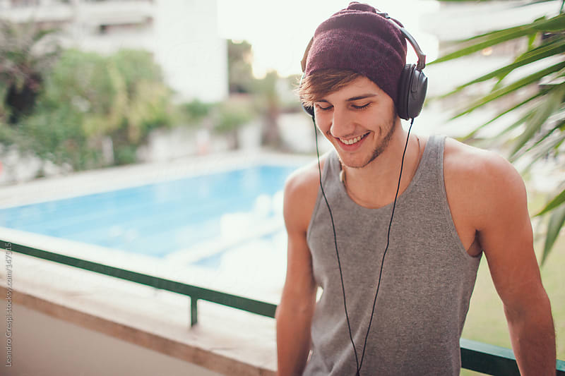 Man listen music with headphones by Leandro Crespi for Stocksy United