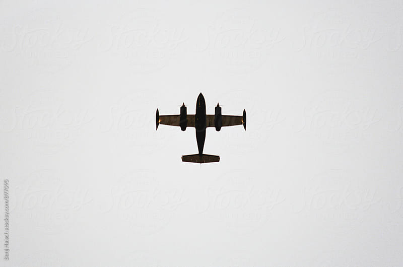 An Airplane Flies Directly Overhead. by Benj Haisch for Stocksy United