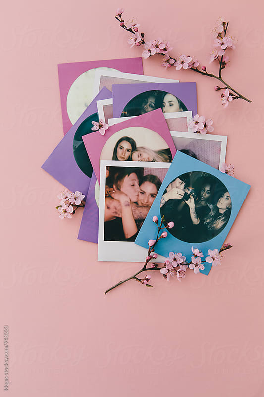 Polaroid print of best friends on a pink background with pink flowers by kkgas for Stocksy United