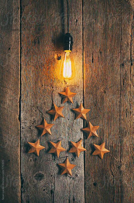 Rustic: Magical Christmas Tree Made Out Of Star Ornaments by Sean Locke for Stocksy United