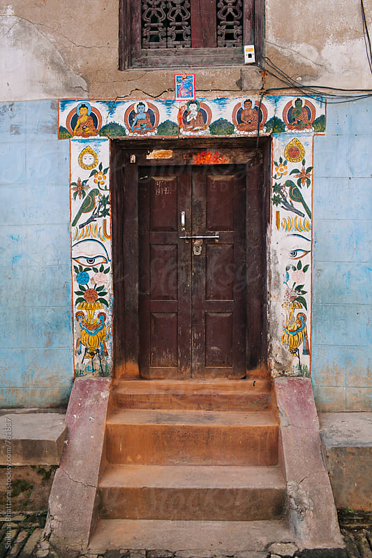Beautifully decorated entrance door to a house in Kathmandu. by Shikhar Bhattarai for Stocksy United