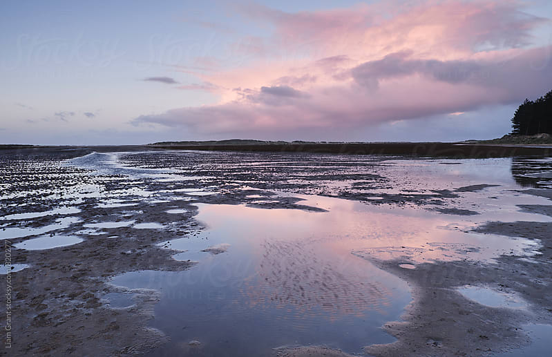 Low tide at twilight. Holkham, Norfolk, UK. by Liam Grant for Stocksy United