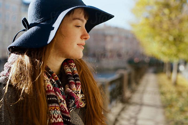 Portrait of young woman in sunny autumn day by Lyuba Burakova for Stocksy United
