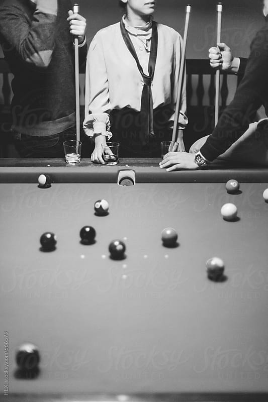 Best Friends Playing Billiards in a Pool Table by HEX. for Stocksy United