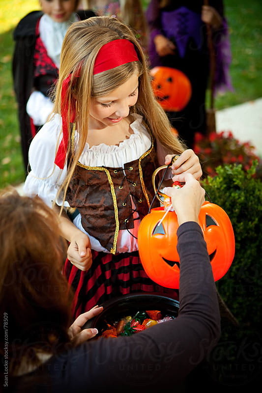 Halloween: Girl Excited to Get Candy by Sean Locke for Stocksy United