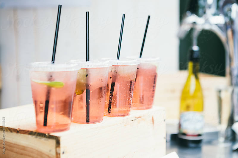 Freshly made Rose wine spritzers with drinking straws by kkgas for Stocksy United