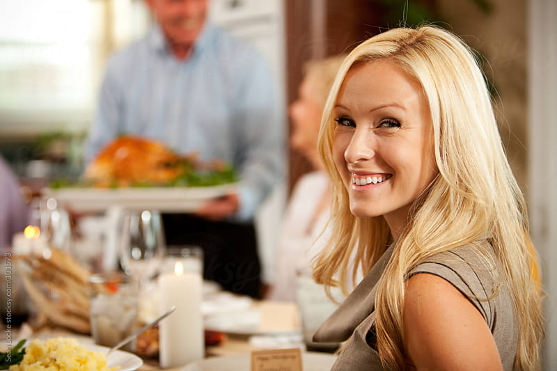Thanksgiving: Cheerful Woman at Thanksgiving Dinner by Sean Locke for Stocksy United
