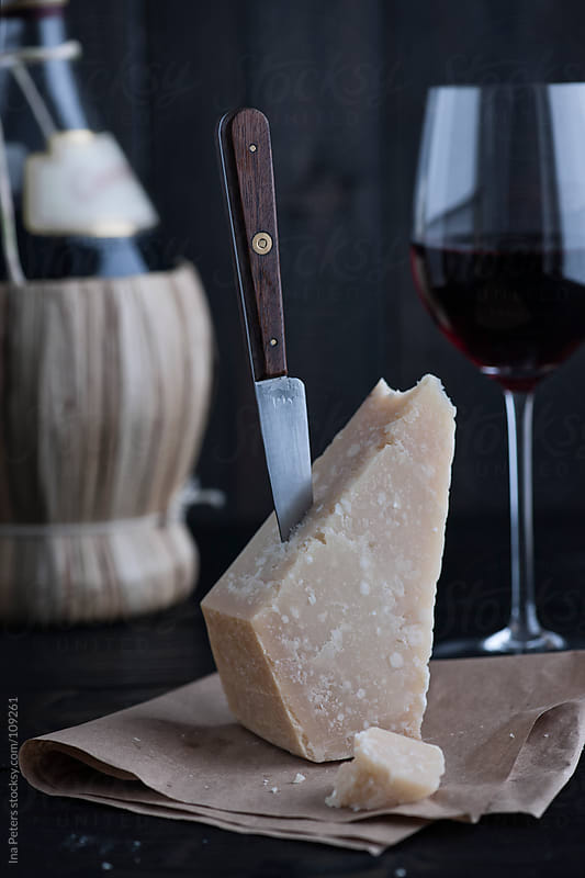 Food: Grana Padano, italian Cheese with Chianti by Ina Peters for Stocksy United