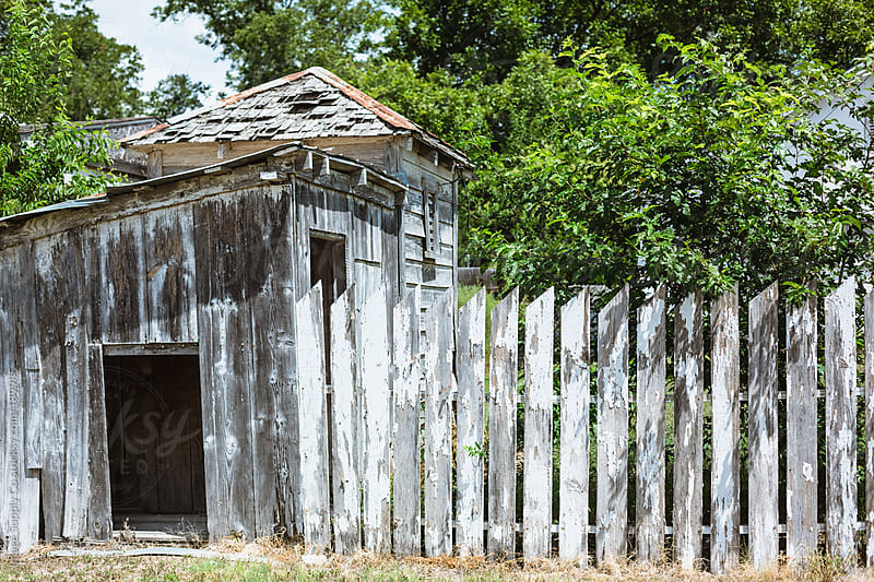 Weathered fence and cubby house by Image Supply Co for Stocksy United