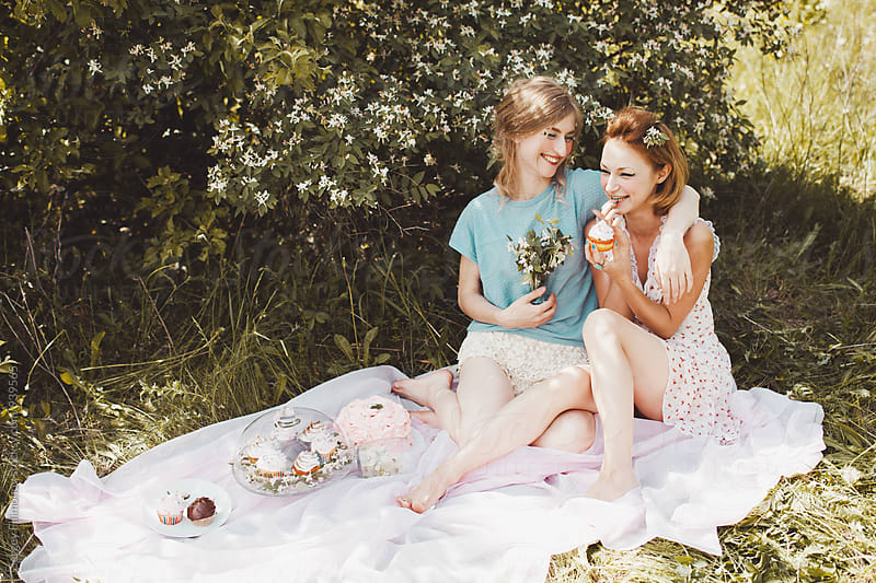 Two beautiful young friend eat sweets and cakes by Sergey Filimonov for Stocksy United