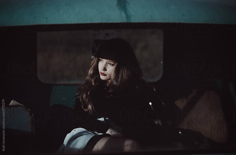 Girl in car by Koki Jovanovic for Stocksy United