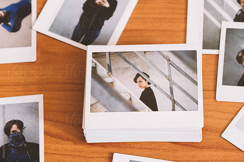 instant photos on the desk by Alexey Kuzma for Stocksy United