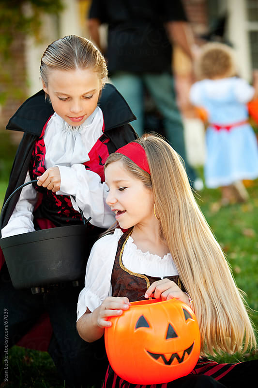 Halloween: Boy Looks to Trade Candy by Sean Locke for Stocksy United