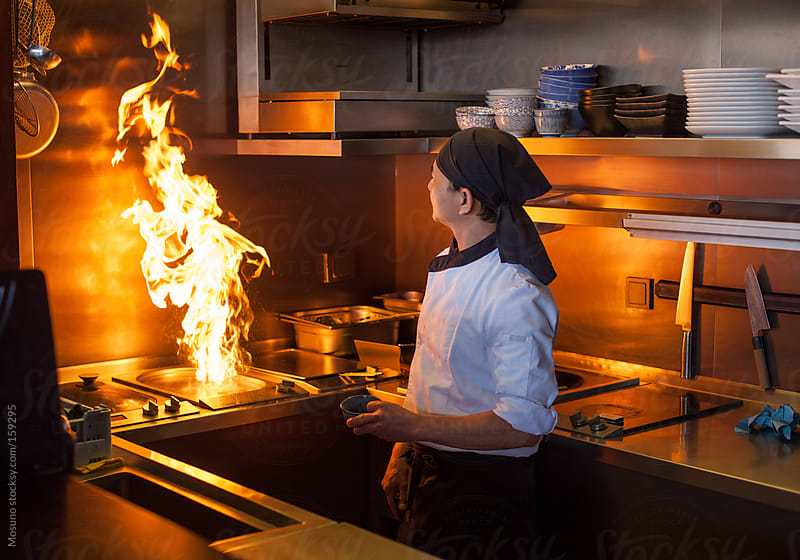 Chef Cooking on Fire in a Japanese Restaurant by Mosuno for Stocksy United