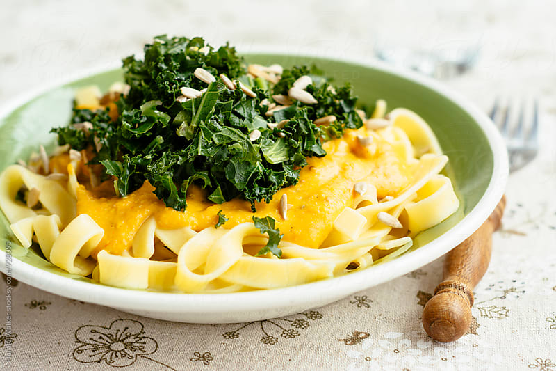 Tagliatelle with Vegan Pumpkin Sauce and Kale by Harald Walker for Stocksy United