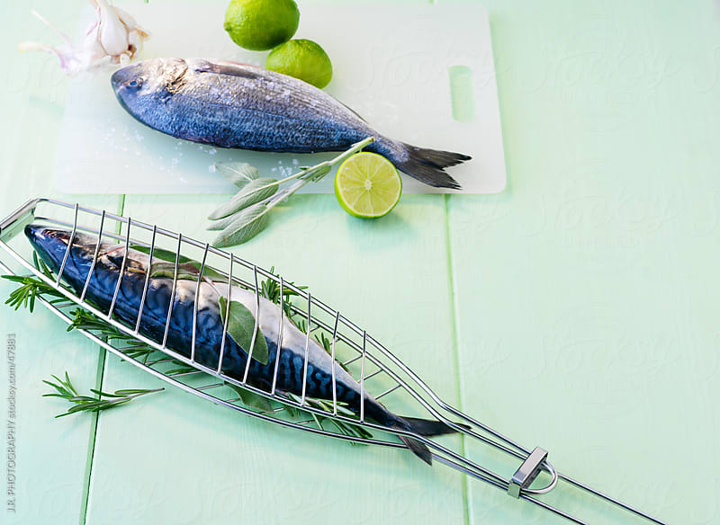 Fish barbecue, sea bream and mackerel by J.R. PHOTOGRAPHY for Stocksy United