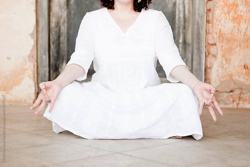 Woman doing yoga mudra by Christine Hewitt for Stocksy United