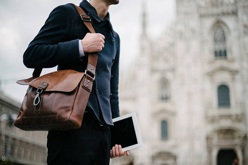 Young businessman in the city, Piazza Duomo Milano by GIC for Stocksy United
