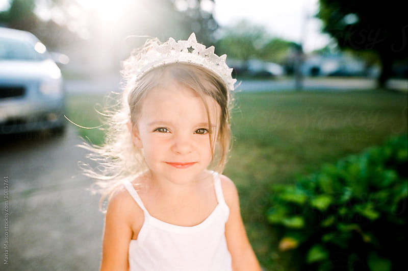 portrait of little girl wearing crown by Maria Manco for Stocksy United