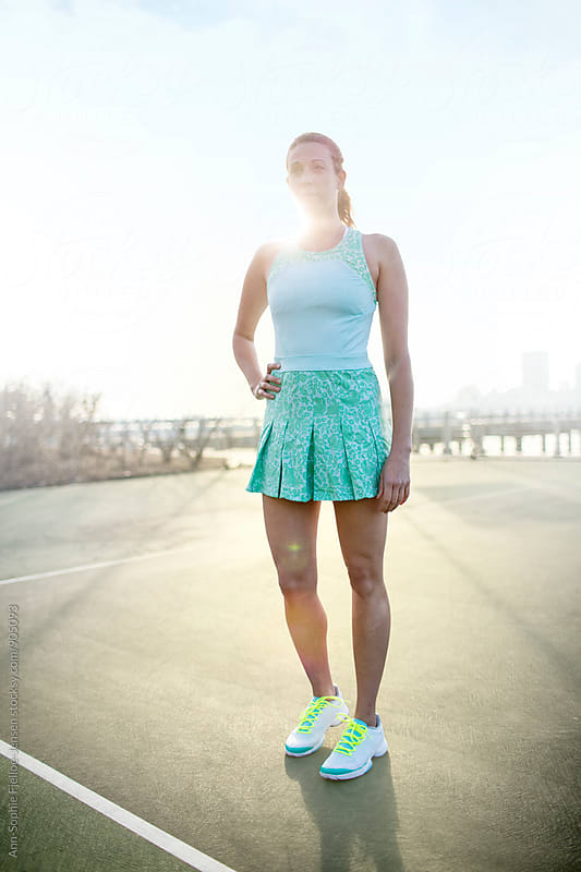 Woman on Tennis Court by Ann-Sophie Fjelloe-Jensen for Stocksy United