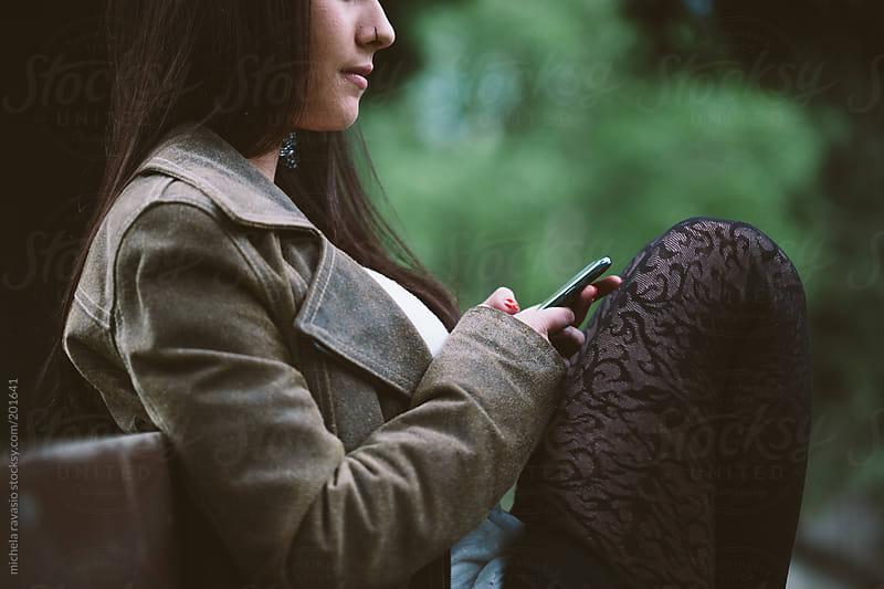 Teenage girl using mobile phone by michela ravasio for Stocksy United