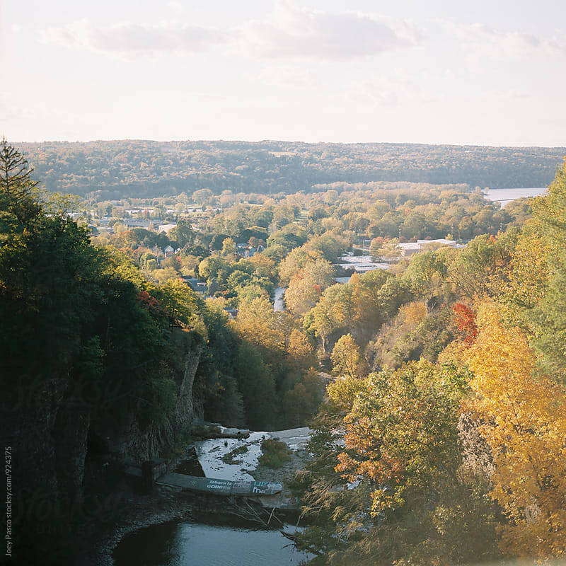 Expanse of autumn foliage at sunset from the top of Ithaca Falls by Joey Pasco for Stocksy United