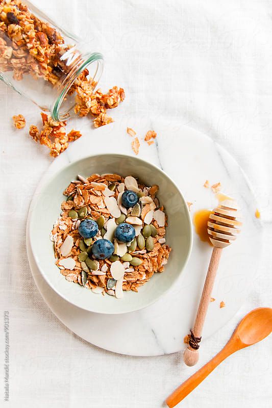 Muesli with almonds, sunflower seeds and blueberries by Nataša Mandić for Stocksy United
