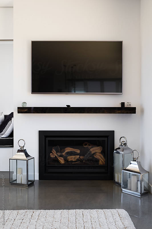 Lounge with fireplace by Rowena Naylor for Stocksy United