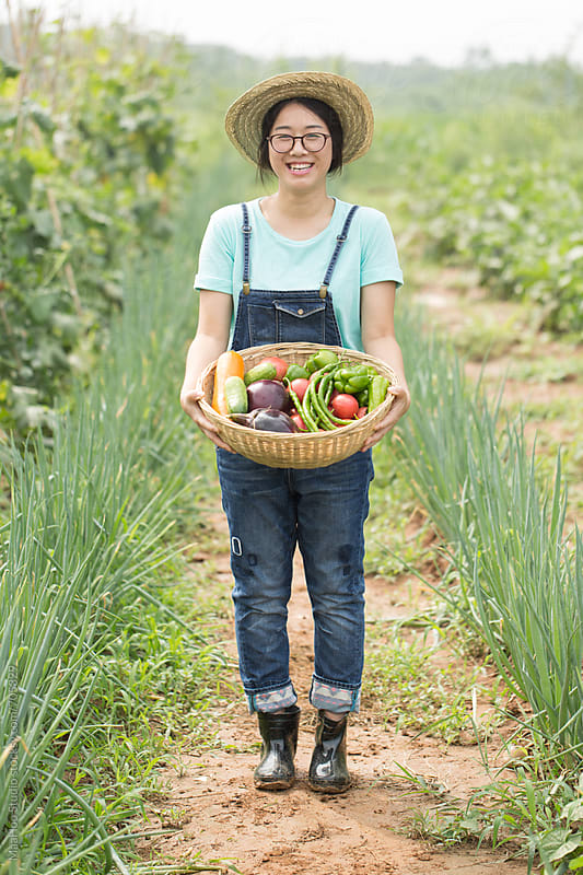 Young Chinese girl working on the farm by Maa Hoo for Stocksy United