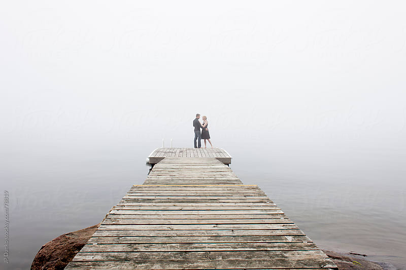 Couple On Cottage Lake Dock In Early Morning by JP Danko for Stocksy United
