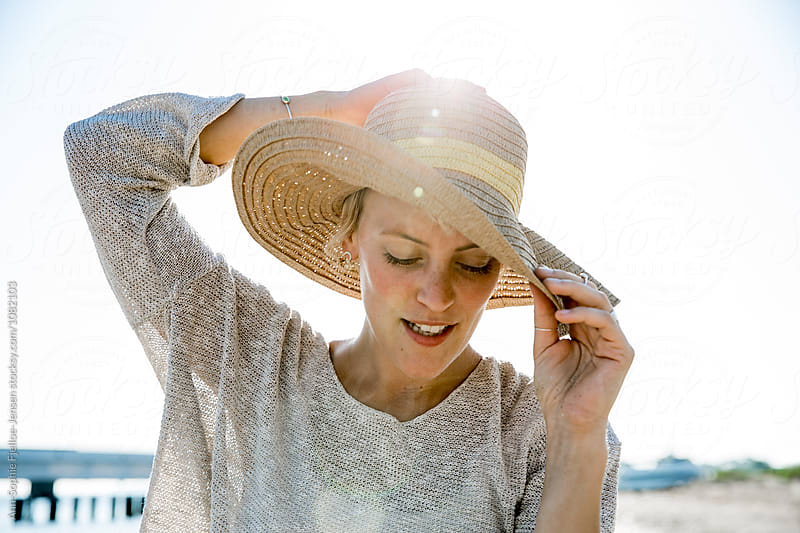 A portrait of a woman on the beach by Ann-Sophie Fjelloe-Jensen for Stocksy United
