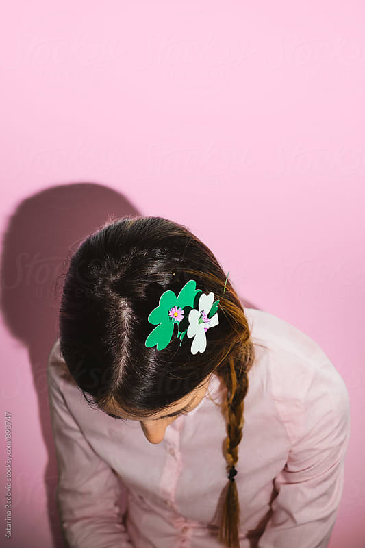 Young Woman With Shamrock Decoration in Her Hair by Katarina Radovic for Stocksy United