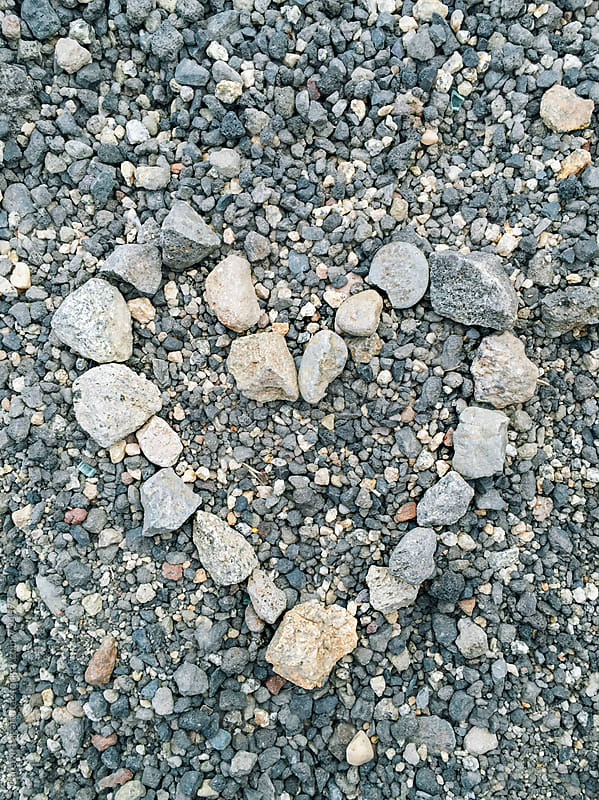 Rocks formed into the shape of a heart by Carolyn Lagattuta for Stocksy United