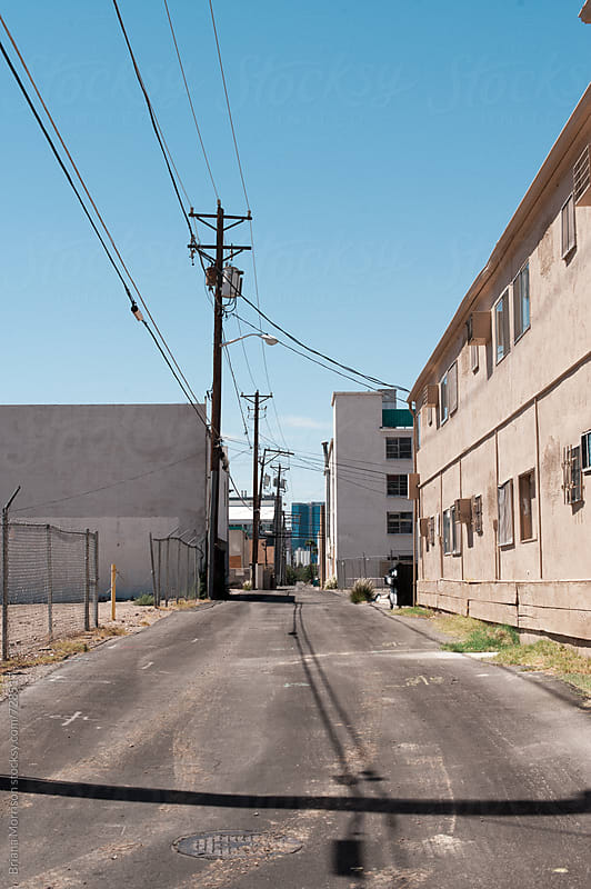 Power Lines and Shadows in a Las Vegas Alley by Briana Morrison for Stocksy United