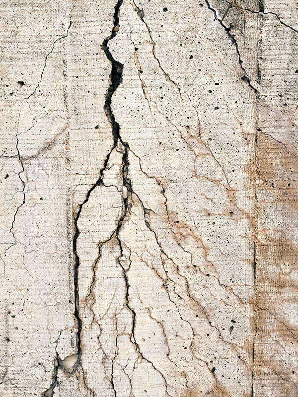 Detail of cracked and fractured concrete wall by Paul Edmondson for Stocksy United