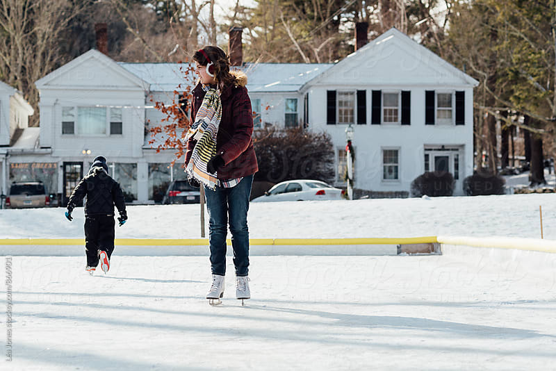 teenager and little brother skating by Léa Jones for Stocksy United
